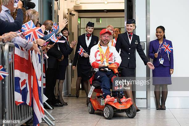Gold medallist Lee Pearson is greeted by supporters after arriving on British Airways flight BA2016 from Rio de Janeiro to London Heathrow Terminal 5...