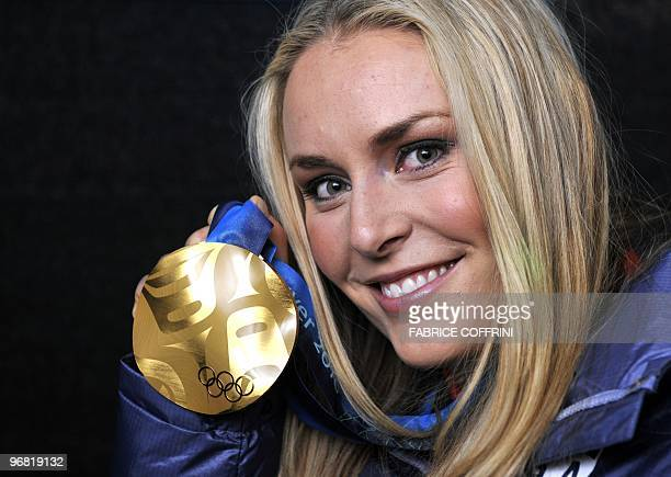 US gold medallist Lindsey Vonn poses during the medal ceremony for the Alpine skiing Ladies downhill event of the Vancouver 2010 Winter Olympics at...