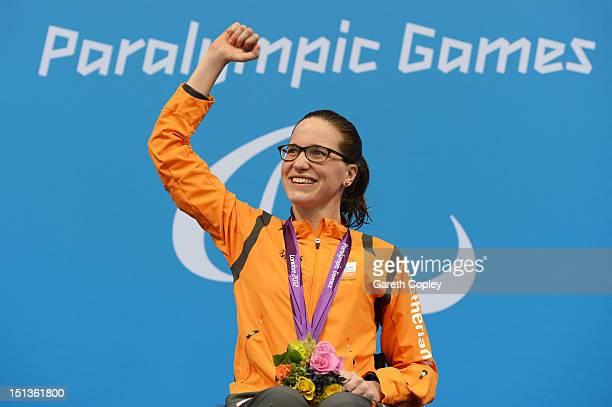 Gold medallist Lisette Teunissen of Netherlands poses on the podium during the medal ceremony for the Women's 50m Backstroke S4 finalon day 8 of the...