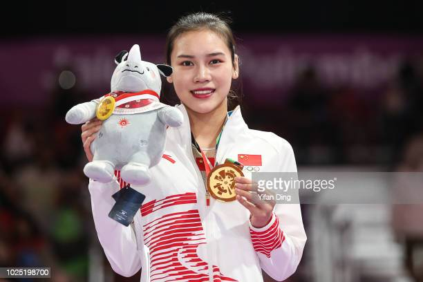 Gold medallist Liu Lingling of China poses for photo during Gymnastics Women's Trampoline medal ceremony at JKT International EXPO on day twelve of...