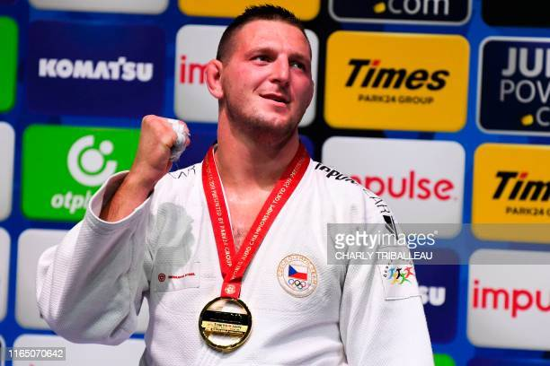 Gold medallist Lukas Krpalek of Czech Republic celebrates on the podium after defeating Japan's Hisayoshi Harasawa in men's over 100kg category final...