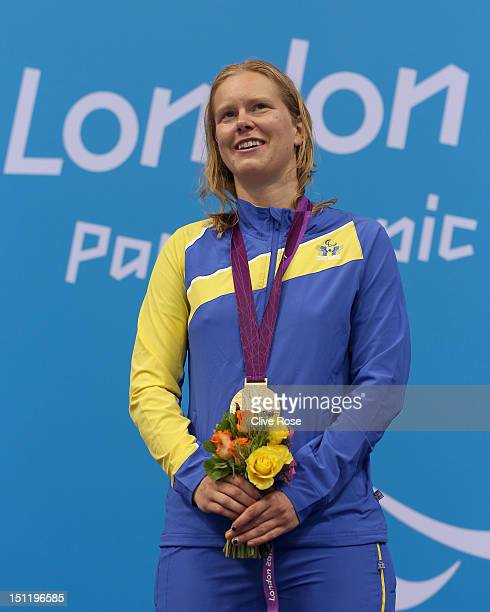 Gold medallist Maja Reichard of Sweden and bronze medallist Nadia Baez of Argentina pose on the podium during the medal ceremony for the Women's 100m...