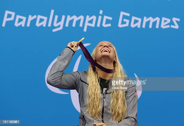 Gold medallist Mallory Weggemann of the United States poses on the podium during the medal ceremony for the Women's 50m Freestyle S8 final on day 4...
