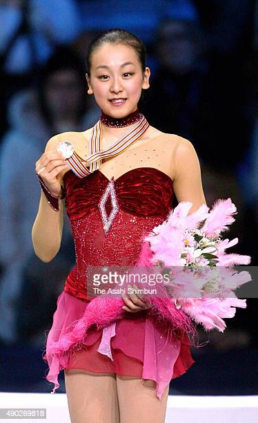 Gold medallist Mao Asada of Japan celebrates on the podium at the medal ceremony for the Ladies Singles during day three of the World Figure Skating...