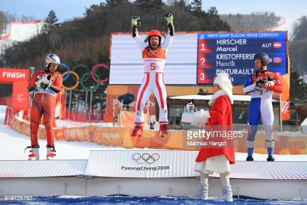 Gold medallist Marcel Hirscher of Austria celebrates with silver medallist Henrik Kristoffersen of Norway and bronze medallist Alexis Pinturault of...