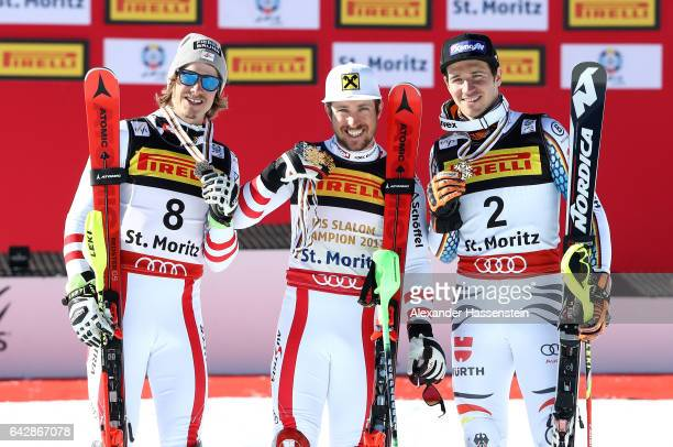 Gold medallist Marcel Hirscher of Austria poses with silver medallist Manuel Feller of Austria and bronze medallist Felix Neureuther of Germany after...