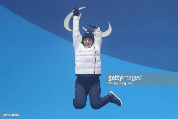 Gold medallist Marie Bochet of France celebrates on the podium during the medal ceremony for the Alpien Skiing Women's Gaint Slalom Standing on day...