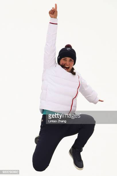 Gold medallist Marie Bochet of France celebrates on the podium during the medal ceremony for the Alpine Skiing Women's Slalom Standing Run 2 during...