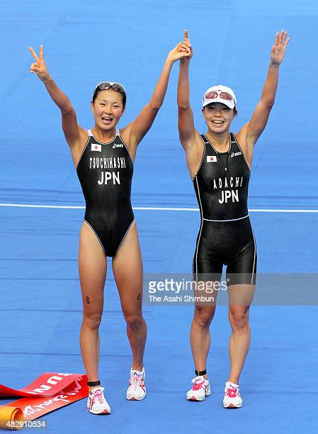 Gold medallist Mariko Adachi and silver medallist Akane Tsuchihashi of Japan pose for photographs after competing in the Women's Triathlon Individual...