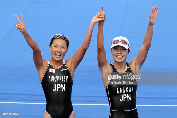 Gold medallist Mariko Adachi and silver medallist Akane Tsuchihashi celebrate after competing in the Women's Triathlon Individual during day one of...