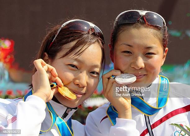 Gold medallist Mariko Adachi and silver medallist Akane Tsuchihashi of Japan pose for photographs at the medal ceremony for the Women's Triathlon...