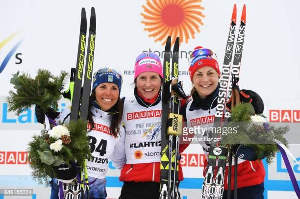Gold medallist Marit Bjoergen of Norway celebrates with silver medallist Charlotte Kalla of Sweden and bronze medallist Astrid Uhrenholdt Jacobsen of...