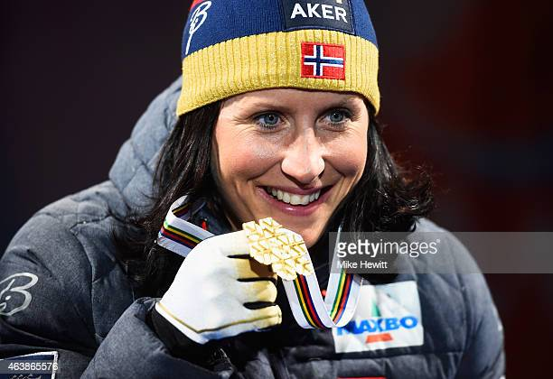 Gold medallist Marit Bjoergen of Norway poses with her medal during the medal ceremony for the Women's Cross-Country Sprint during the FIS Nordic...