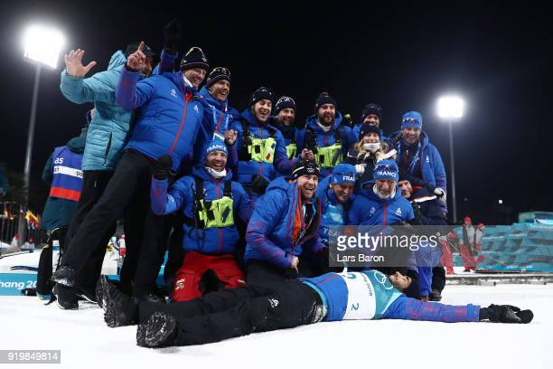 Gold medallist Martin Fourcade of France celebrates with his team during the victory ceremony for the Men's 15km Mass Start Biathlon on day nine of...