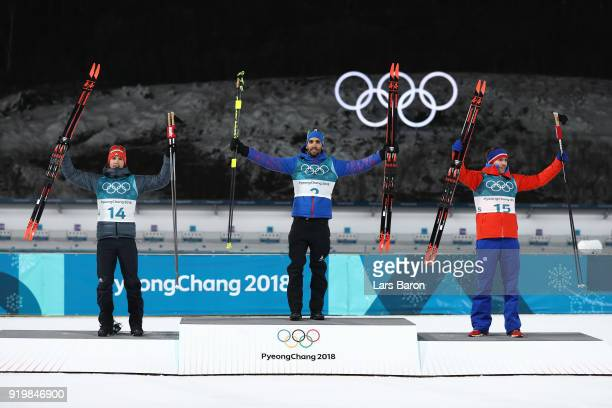 Gold medallist Martin Fourcade of France poses with silver medallist Simon Schempp of Germany and bronze medallist Emil Hegle Svendsen of Norway...