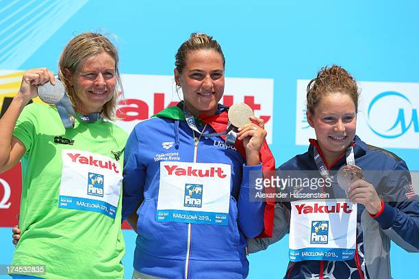 Gold medallist Martina Grimaldi of Italy celebrates with Silver medallist Angela Alexandra Maurer of Germany and Bronce medallist Eva Mariel Fabian...