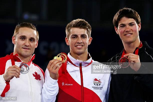 Gold medallist Max Whitlock of England poses with silver medallist Scott Morgan of Canada and bronze medallist David Bishop of New Zealand during the...