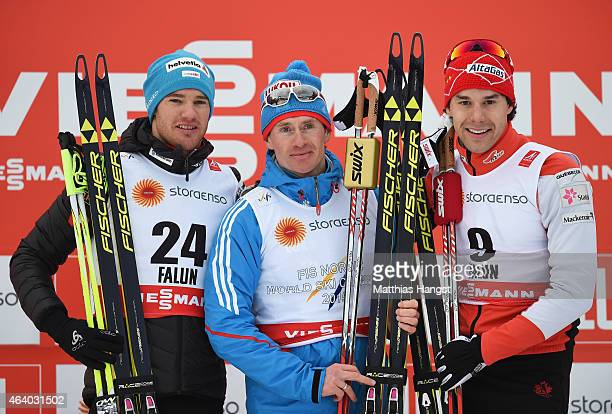 Gold medallist Maxim Vylegzhanin of Russia poses with silver medallist Dario Cologna of Switzerland and bronze medallist Alex Harvey of Canada after...