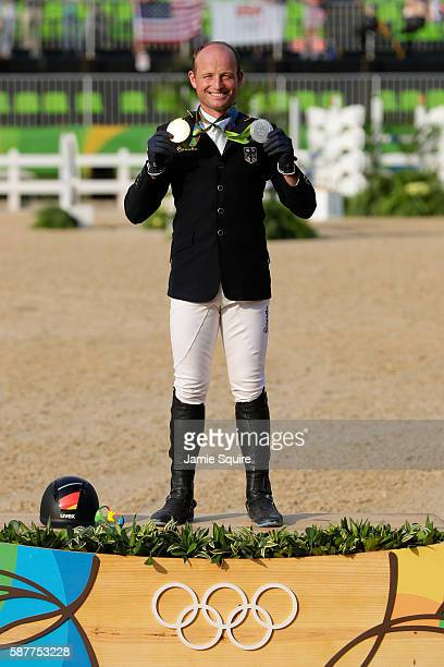 Gold medallist Michael Jung of Germany poses during the medal ceremony for the eventing Individual final on Day 4 of the Rio 2016 Olympic Games at...