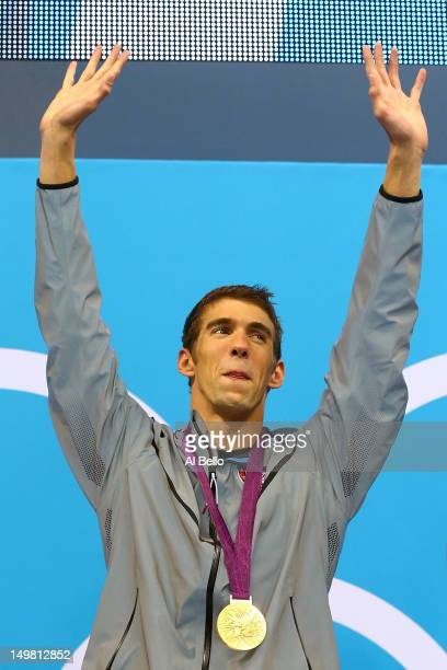 Gold medallist Michael Phelps of the United States celebrates on the podium in the medal ceremony for the Men's 4x100m medley Relay Final on Day 8 of...