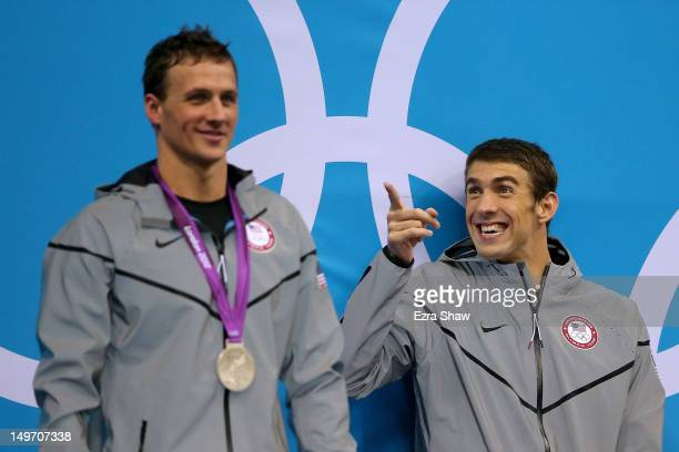 Gold medallist Michael Phelps of the United States reacts whilst waiting the receive hsi medal alongside Silver medallist Ryan Lochte of the United...