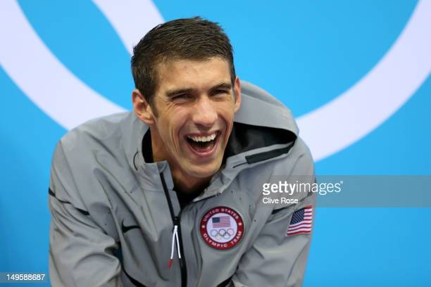 Gold Medallist Michaell Phelps of the United States smiles prior to receiving his medal on the podium during the medal ceremony for the Men's 4 x...