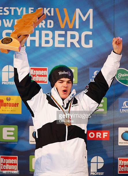 Gold medallist Mikael Kingsbury of Canada celebrates during the medal ceremony for the Men's Dual Moguls Final of the FIS Freestyle Ski and Snowboard...