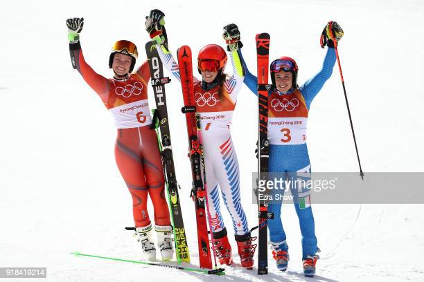Gold medallist Mikaela Shiffrin of the United States celebrates with silver medallist Ragnhild Mowinckel of Norway and bronze medallist Federica...
