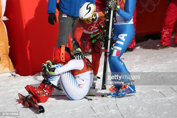 Gold medallist Mikaela Shiffrin of the United States celebrates with silver medallist Ragnhild Mowinckel of Norway during the Ladies' Giant Slalom on...