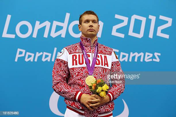 Gold medallist Mikhail Zimin of Russia poses on the podium during the medal ceremony for the Men's 100m Breaststroke SB12 final on day 10 of the...
