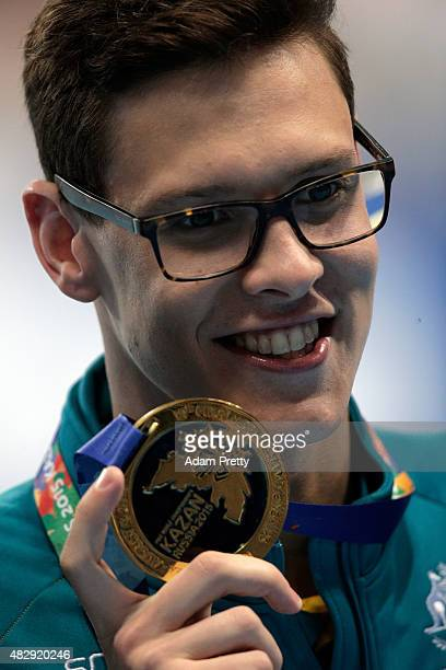 Gold medallist Mitch Larkin of Australia poses during the medal ceremony for the Men's 100m Backstroke Final on day eleven of the 16th FINA World...