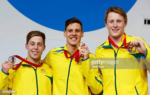Gold medallist Mitch Larkin of Australia poses with silver medallist Josh Beaver of Australia and bronze medallist Matson Lawson of Australia during...