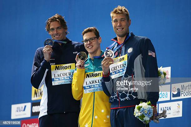 Gold medallist Mitch Larkin of Australia poses with silver medallist Camille Lacourt of France and bronze medallist Matt Grevers of the United States...