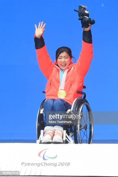 Gold medallist Momoka Muraoka of Japan celebrates on the podium during the medal ceremony for Alpien Skiing Women's Gaint Slalom Sitting on day six...