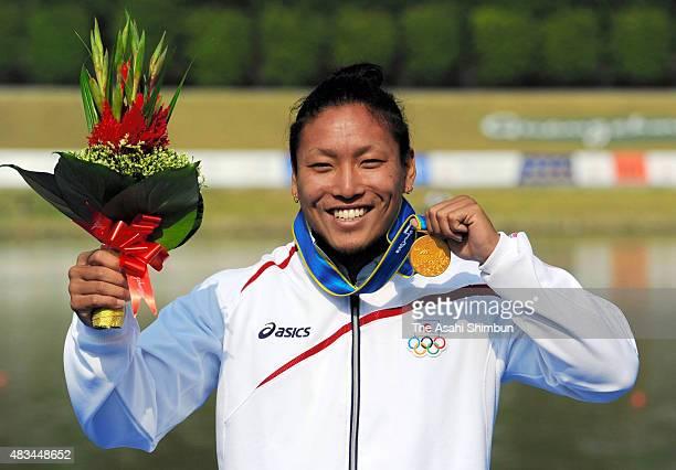 Gold medallist Momotaro Matsushita of Japan celebrates on the podium at the medal ceremony for the Canoe Sprint Men's Kayak Single 200m during the...