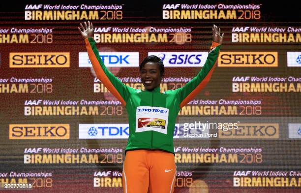 Gold Medallist Murielle Ahoure of Cote D'Ivoire celebrates on the podium after winning the 60 Metres womens during the IAAF World Indoor...