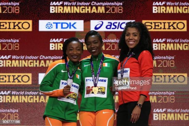 Gold Medallist Murielle Ahoure Silver Medallist MarieJosee Ta Lou of Cote D'Ivoire and Bronze Medallist Mujinga Kambundji of Switzerland celebrates...