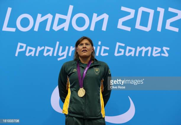 Gold medallist Natalie du Toit of South Africa poses on the podium during the medal ceremony for the Women's 100m Butterfly S9 final on day 1 of the...