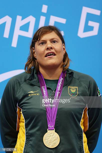 Gold medallist Natalie du Toit of South Africa poses on the podium during the medal ceremony for the Women's 400m Freestyle S9 final on day 6 of the...