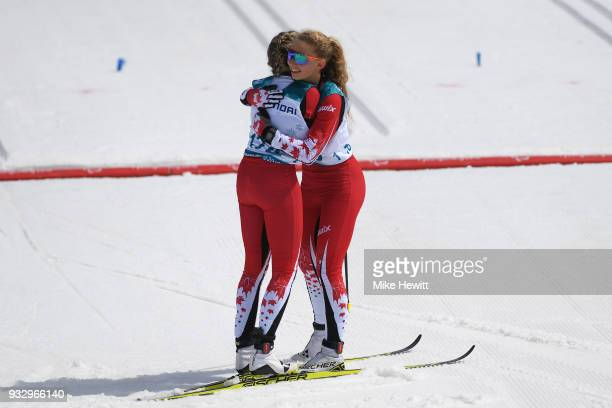 Gold medallist Natalie Wilkie of Canada celebrates with team mate and Bronze medallist Emily Young after the Women's Cross Country Skiing 75km...