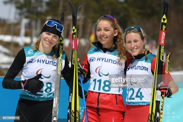 Gold medallist Natalie Wilkie of Canada Silver medallist Ekaterina Rumyantseva and Bronze medallist Emily Young of Canada celebrate during the...