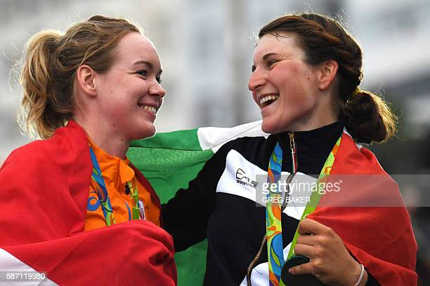 Gold medallist Netherlands' Anna Van Der Breggen and bronze medallist Italy's Elisa Longo Borghini pose on the podium after the Women's road cycling...