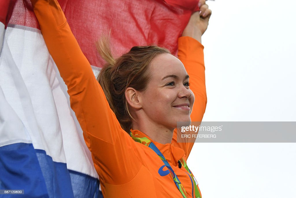 Gold medallist Netherlands' Anna Van Der Breggen poses on the podium after the Women's road cycling race at the Rio 2016 Olympic Games in Rio de Janeiro on August 7, 2016. / AFP / Eric FEFERBERG