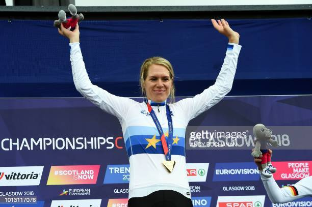 Gold medallist Netherlands' Ellen Van Dijk poses on the podium during the medal ceremony for the women's cycling road race time trial final during...