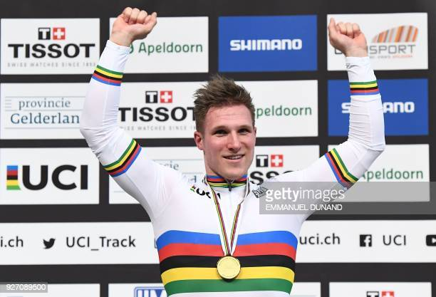 Gold medallist Netherland's Jeffrey Hoogland celebrates on the podium after taking part in the men's one kilometre time trial final during the UCI...