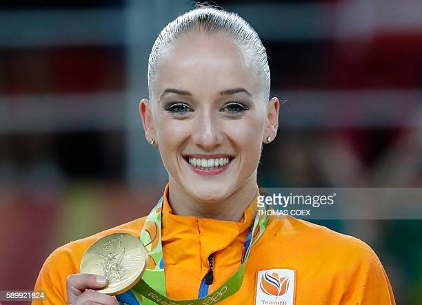 Gold medallist Netherlands' Sanne Wevers poses on the podium of the women's balance beam event final of the Artistic Gymnastics at the Olympic Arena...