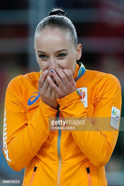 Gold medallist Netherlands' Sanne Wevers reacts on the podium of the women's balance beam event final of the Artistic Gymnastics at the Olympic Arena...