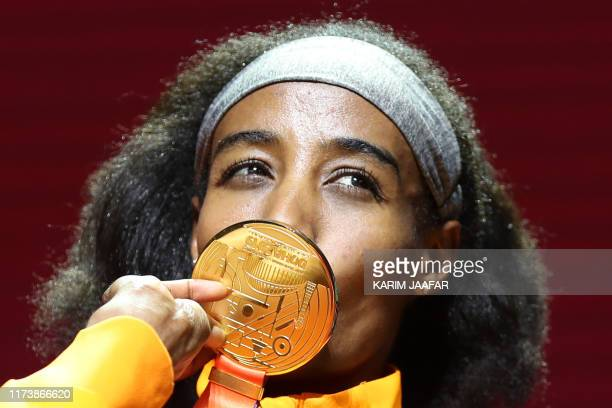 Gold medallist Netherlands' Sifan Hassan poses on the podium during the medal ceremony for the Women's 1500m at the 2019 IAAF Athletics World...