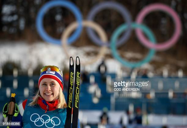 TOPSHOT Gold medallist Norway's Ragnhild Haga celebrates during the victory ceremony at the end of the women's 10km freestyle crosscountry...