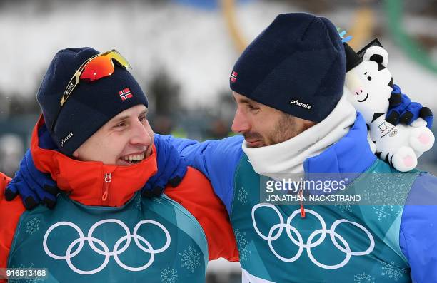 TOPSHOT Gold medallist Norway's Simen Hegstad Krueger and bronze medallist Norway's Hans Christer Holund celebrate during the victory ceremony at the...